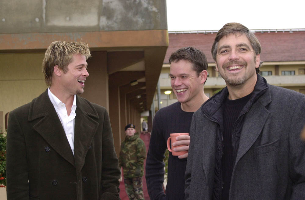 Brad Pitt, Matt Damon and George Clooney enjoy a morning laugh Dec. 7, 2001 prior to their tour of Incirlik Air Base, Turkey. The trio, along with Julia Roberts and Andy Garcia, visited Incirlik to show their appreciation to troops serving in the military. U.S. Air Force photo by Airman 1st Class Tanaya M. Harms. (RELEASED)