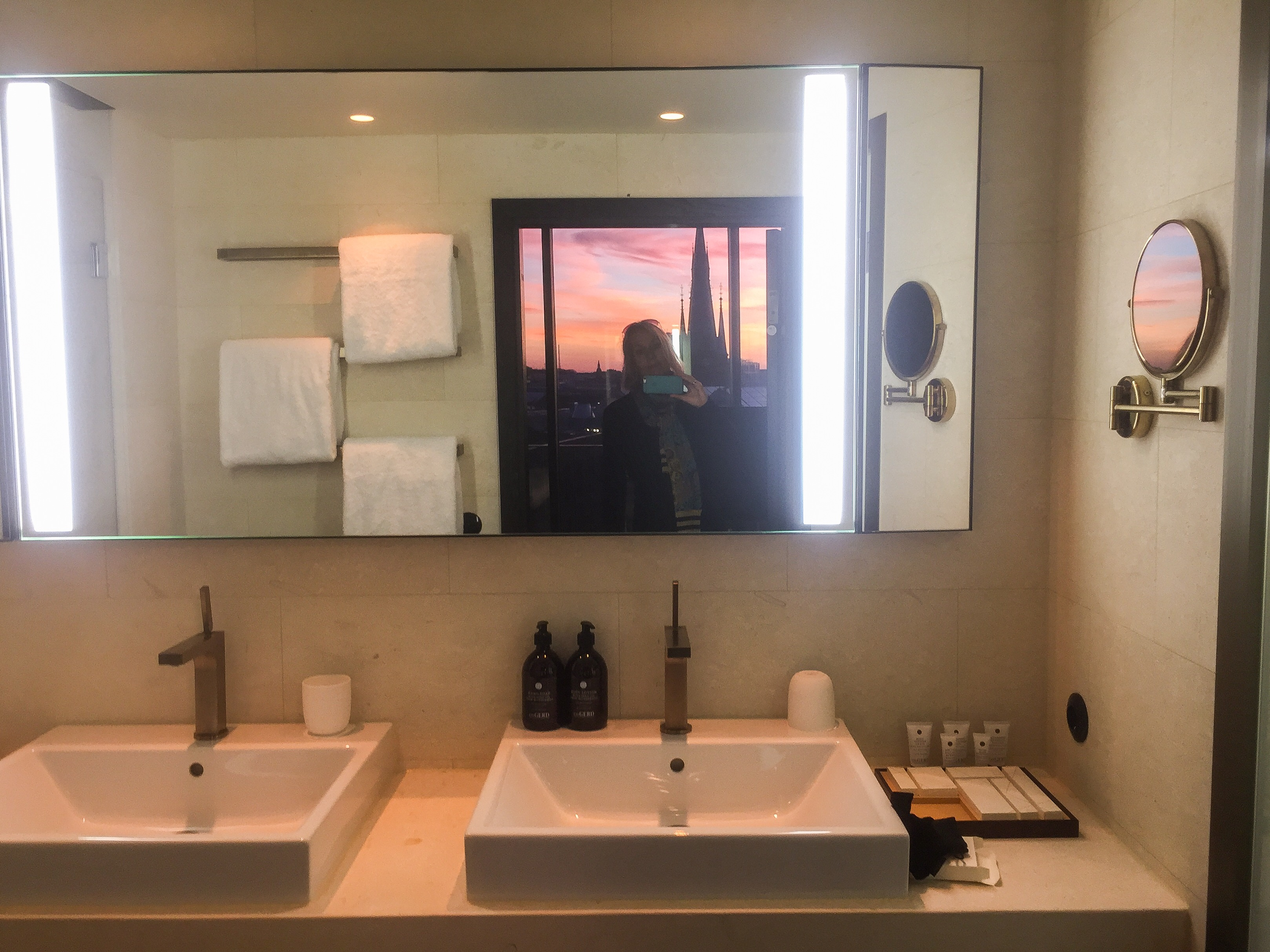 sunset in bathroom-mirror-at-six